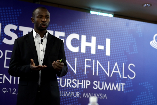 Chris pitching his startup at the GIST Tech-I 2013 finals in Kuala Lumpur, Malaysia